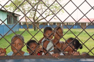 Neighborhood children observing surgery through the window of the classroom where the clinic was being held in Overhaul, a small town a few miles away from Pearl Lagoon.