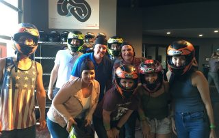 go-kart racing group photo in helmets